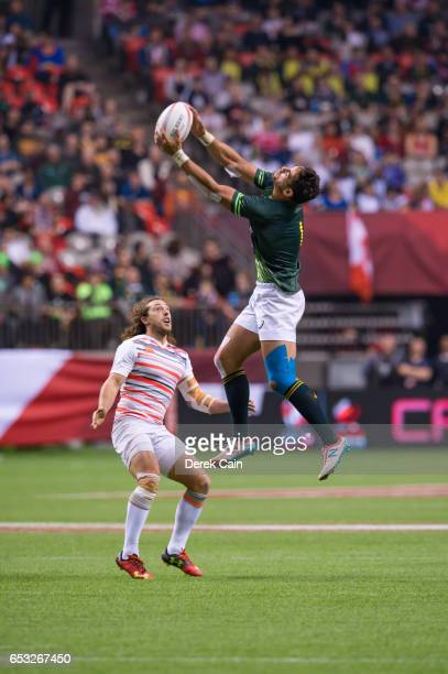 Chris Dry of South Africa jumps in the air to catch the ball as Dan Bibby of England watches during the Cup Final on day 2 of the 2017 Canada Sevens...