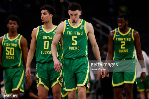 Chris Duarte and the Oregon Ducks react in the second half of their Sweet Sixteen round game against the USC Trojans the 2021 NCAA Men's Basketball...