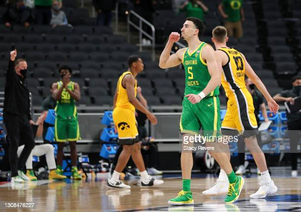 Chris Duarte of the Oregon Ducks celebrates during the game against the Iowa Hawkeyes in the second round game of the 2021 NCAA Men's Basketball...
