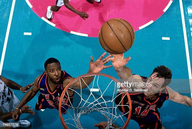 Chris Dudley and Charlie Ward of the New York Knicks battle for the rebound during Game One of the 1999 NBA Finals played at the Alamodome on June 16...