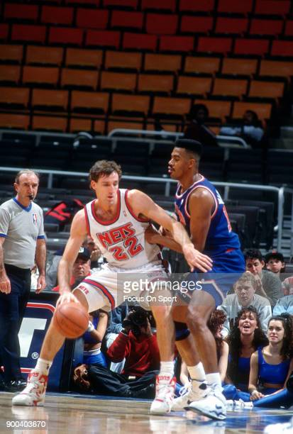 Chris Dudley of the New Jersey Nets backs in on Hot Rod Williams of the Cleveland Cavaliers during an NBA basketball game circa 1991 at the Brendan...