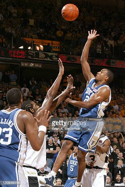 Chris Duhon floats a shot over Eric Williams during the second half of Wake Forest's 9084 upset of Duke February 18 2004