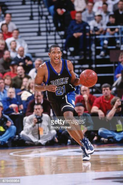 Chris Duhon of the Duke Blue Devils handles the ball against the Stanford Cardinals on December 21 2000 at ORACLE Arena in Oakland California NOTE TO...