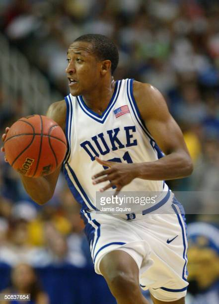 Chris Duhon of the Duke Blue Devils moves the ball up court against the Xavier Musketeers during the fourth round game of the NCAA Division I Men's...