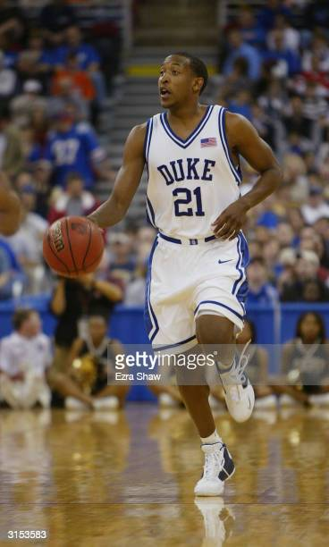 Chris Duhon of the Duke Blue Devils moves the ball up court during the first round game of the NCAA Division I Men's Basketball Tournament against...