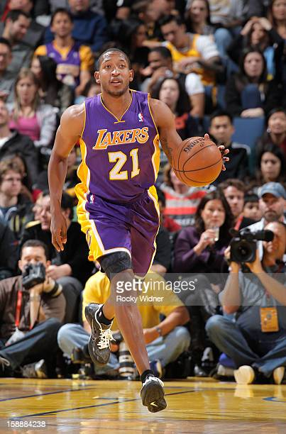 Chris Duhon of the Los Angeles Lakers brings the ball up the court against the Golden State Warriors on December 22 2012 at Oracle Arena in Oakland...