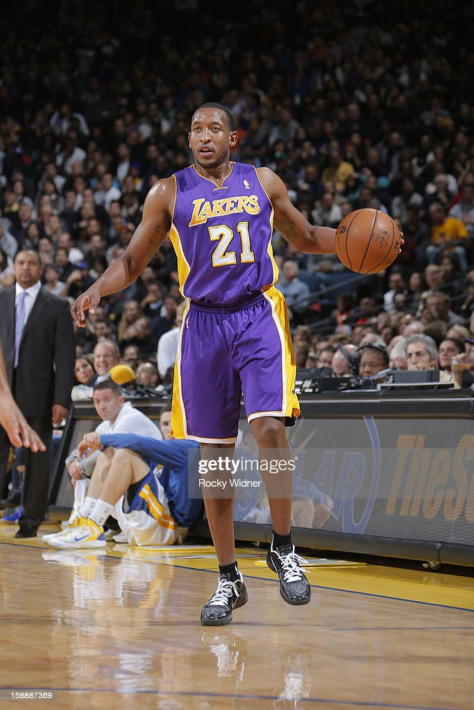 Chris Duhon #21 of the Los Angeles Lakers surveys the defense of the Golden State Warriors on December 22, 2012 at Oracle Arena in Oakland, California.