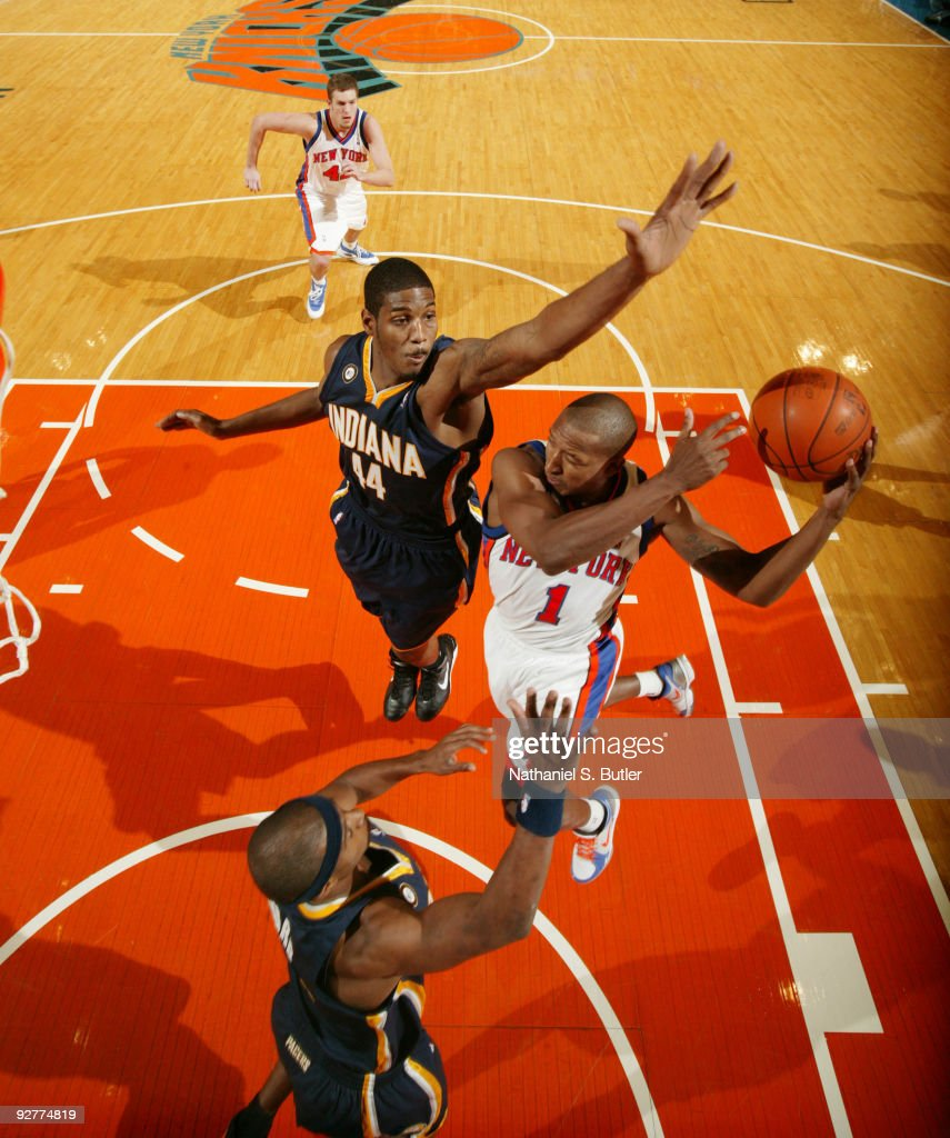 Chris Duhon #1 of the New York Knicks looks to pass against Solomon Jones #44 of the Indiana Pacers on November 4, 2009 at Madison Square Garden in New York City.
