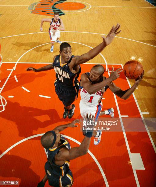 Chris Duhon of the New York Knicks looks to pass against Solomon Jones of the Indiana Pacers on November 4 2009 at Madison Square Garden in New York...