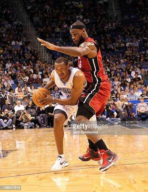 Chris Duhon of the Orlando Magic is guarded by LeBron James of the Miami Heat during the game at Amway Center on February 8 2012 in Orlando Florida...