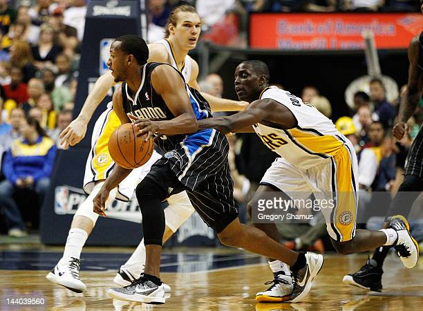 Chris Duhon of the Orlando Magic tries to get around the defense of Darren Collison of the Indiana Pacers in Game Five of the Eastern Conference...