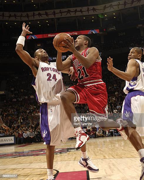 Chris Duhon of the the Chicago Bulls drives in against Morris Peterson of the Toronto Raptors on January 25 2006 at the Air Canada Centre in Toronto...