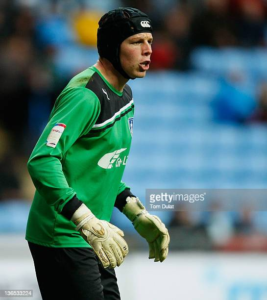 Chris Dunn of Coventry City looks on during the FA Cup 3rd round match between Coventry City and Southampton at the Ricoh Arena on January 07 2012 in...
