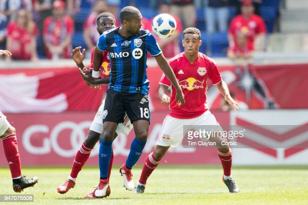 Chris Duvall of Montreal Impact challenged by Tyler Adams of New York Red Bulls and Kemar Lawrence of New York Red Bulls during the New York Red...