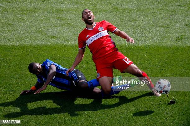 Chris Duvall of Montreal Impact fouls Arturo Alvarez of Chicago Fire and received a yellow card during the second half at Toyota Park on April 1,...