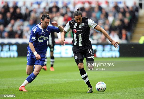 Chris Eagles challenges Jonas Gutierrez of Newcastle during the Barclays Premier League match between Newcastle United and Bolton Wanderers at The...
