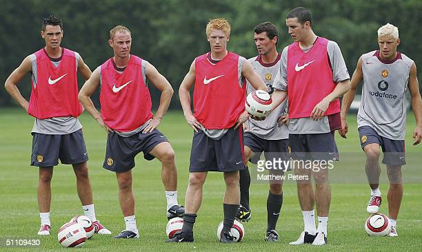 Chris Eagles Nicky Butt Paul McShane Roy Keane John O'Shea and Alan Smith of Manchester United watch from the sidelines during a training session at...