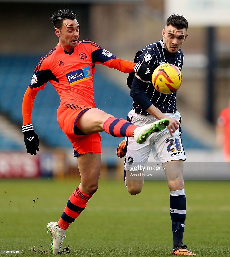 Chris Eagles of Bolton (L) in action with Scott Malone of Millwall during the Sky Bet Championship match between Millwall and Bolton Wanderers at The Den on February 15, 2014 in London, England.