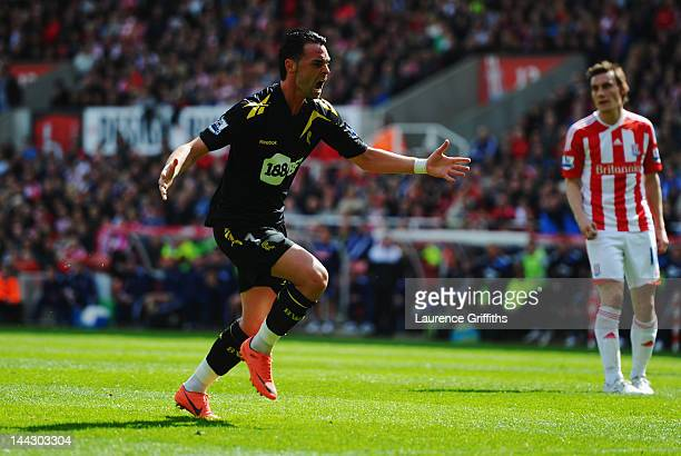 Chris Eagles of Bolton Wanderers celebrates as Mark Davies scores their first goal during the Barclays Premier League match between Stoke City and...