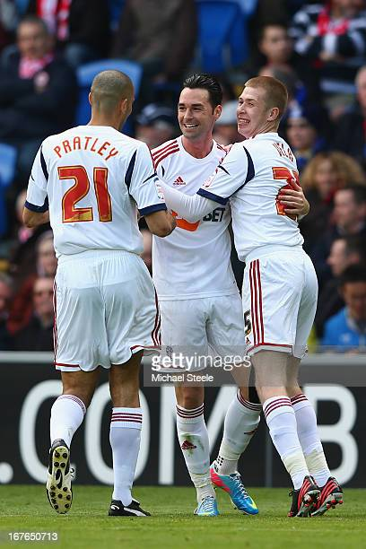 Chris Eagles of Bolton Wanderers celebrates scoring the opening goal with Darren Pratley and Josh Vela during the npower Championship match between...