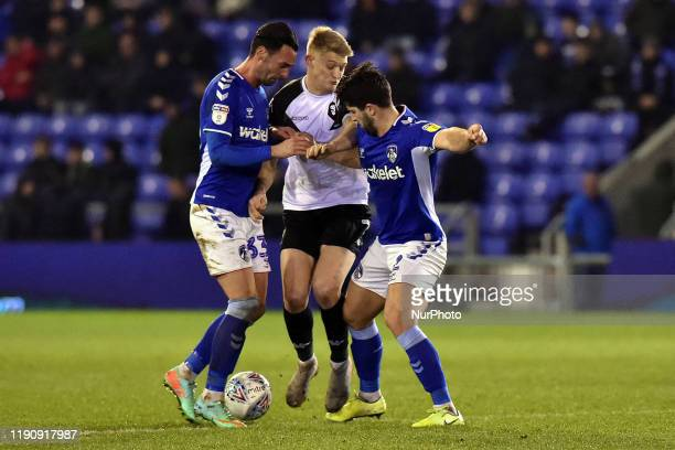 Chris Eagles of Oldham Athletic and Zak Mills of Oldham Athletic and Luke Armstrong of Salford City during the Sky Bet League 2 match between Oldham...