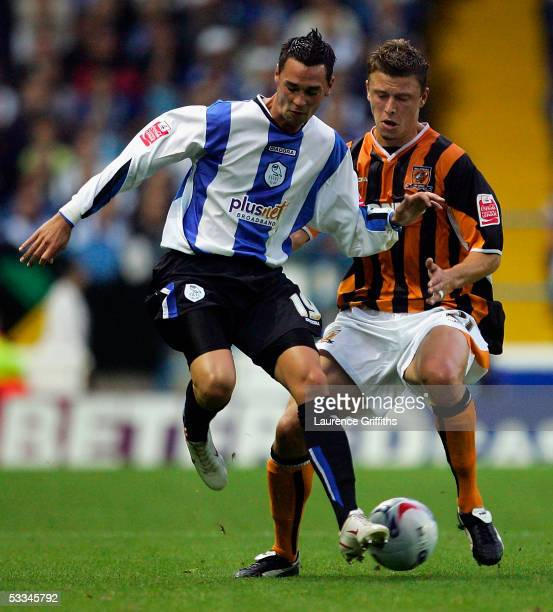 Chris Eagles of Sheffield Wednesday battles for the ball with Danny Coles of Hull City during the CocaCola Championship match between Sheffield...