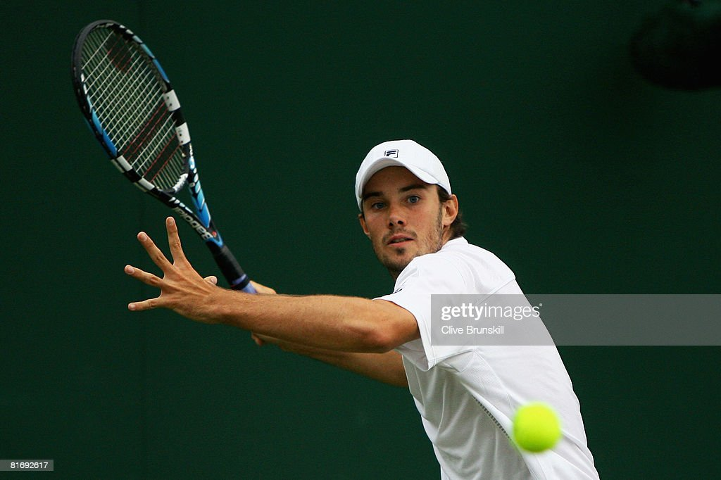 Chris Eaton of United Kingdom plays a forehand during the men's singles round one match against Boris Pashanski of Serbia on day two of the Wimbledon Lawn Tennis Championships at the All England Lawn Tennis and Croquet Club on June 24, 2008 in London, England.
