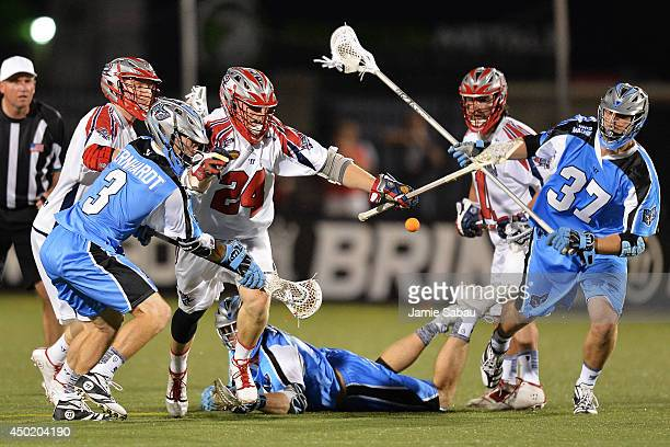 Chris Eck of the Boston Cannons battles for control of a loose ball with Jake Bernhardt of the Ohio Machine and Brian Farrell of the Ohio Machine in...