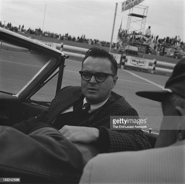 Chris Economaki prepares for a parade lap in the passernger seat before the start of the Motor Trend 500 in January 1964