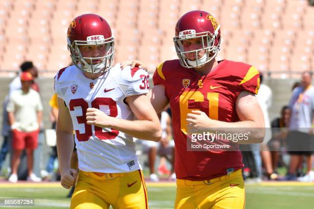 Chris Edmondson escorts USC Jake Olson who is blind during the USC spring football game on April 15 at the Los Angeles Memorial Coliseum in Los...