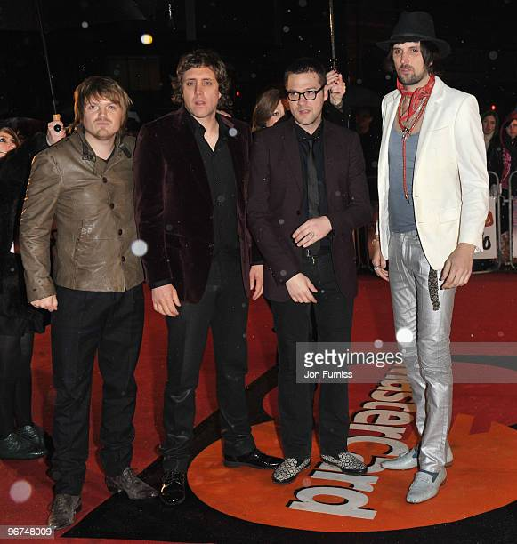 Chris Edwards Ian Matthews Tom Meighan and Serio Pizzorno of Kasabian arrive on the red carpet for The Brit Awards 2010 at Earls Court on February 16...