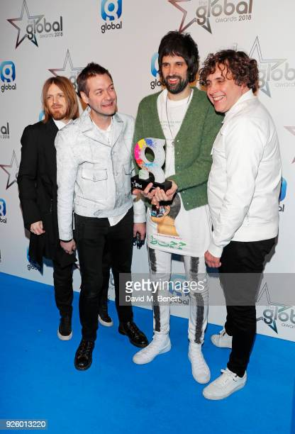 Chris Edwards Tom Meighan Serge Pizzorno and Ian Matthews of Kasabian winners of the Best Indie award attend The Global Awards 2018 at Eventim Apollo...