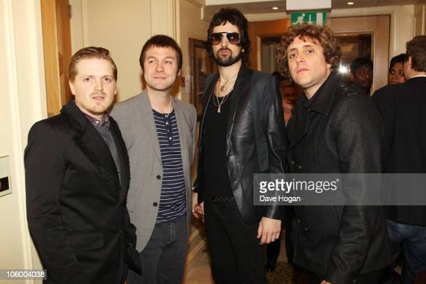 Chris Edwards Tom Meighan Sergio Pizzorno and Ian Matthews of Kasabian pose in the press room at the Q Awards 2010 held at The Grosvenor House Hotel...