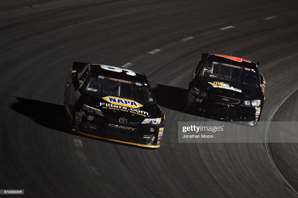 Chris Eggleston, driver of the #99 NAPA Filters Toyota, and Dillon Bassett, driver of the #44 Bassett Gutters and More Toyota, race on track during the NASCAR K&N Pro Series West Coast Stock Car Hall of Fame Championship 150, presented by NAPA Auto Parts at Kern County Raceway Park on November 4, 2017 in Bakersfield, California.