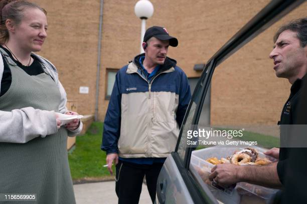 Chris Engelmann right gave donuts to a couple at the Listening House of St Paul Tuesday May 10 2016 in St Paul MN] Chris Engelmann loaded donuts from...