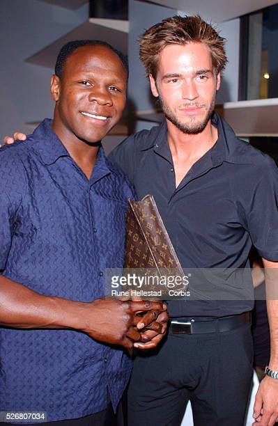 Chris Eubank and Big Brother contestant Alex Sibley attend Esquire magazine's 50 Sharpest Men in Britain 2002 awards at the Bank Aldwych Bar...