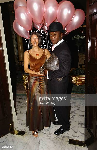 Chris Eubank his Wife arrive at The Pink Ribbon Ball in aid of Breast Cancer at The Dorchester Hotel October 11 2003 in London