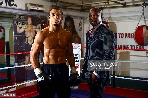 Chris Eubank Jnr and his father Chris Eubank pose for a photo during a media workout at Cheetahs Gym on October 21 2015 in Brighton England