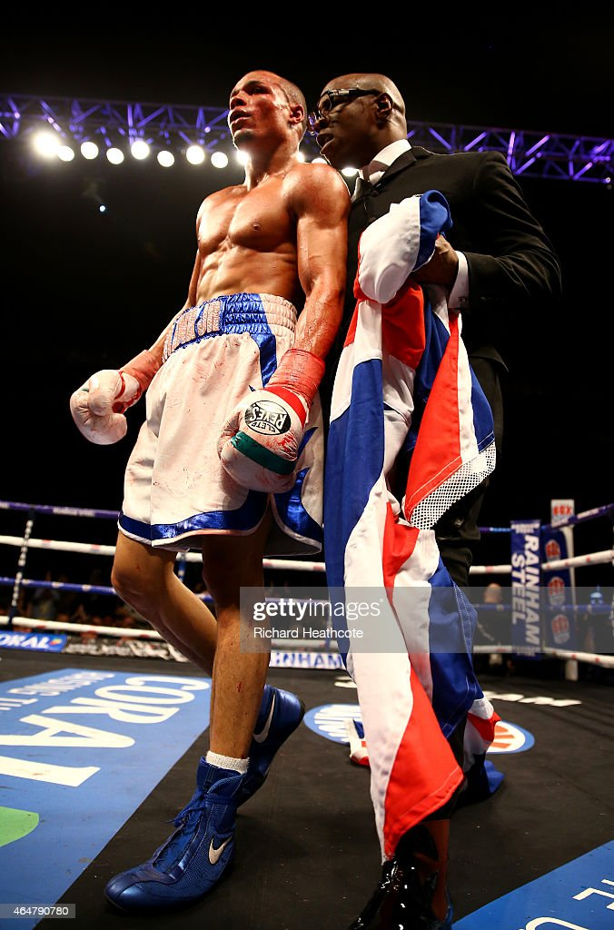 Chris Eubank Jnr is congratulated by his father Chris Eubank as he celebrates victory over Dmitry Chudinov for the WBA Interim World Middleweight Championship at the O2 Arena on February 28, 2015 in London, England.