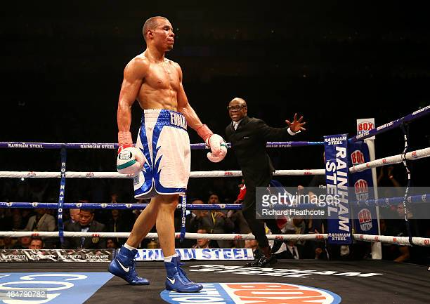 Chris Eubank Jnr is congratulated by his father Chris Eubank as he celebrates victory over Dmitry Chudinov for the WBA Interim World Middleweight...