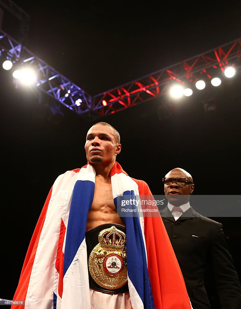 Chris Eubank Jnr is watched by his father Chris Eubank as he celebrates victory over Dmitry Chudinov for the WBA Interim World Middleweight Championship at the O2 Arena on February 28, 2015 in London, England.