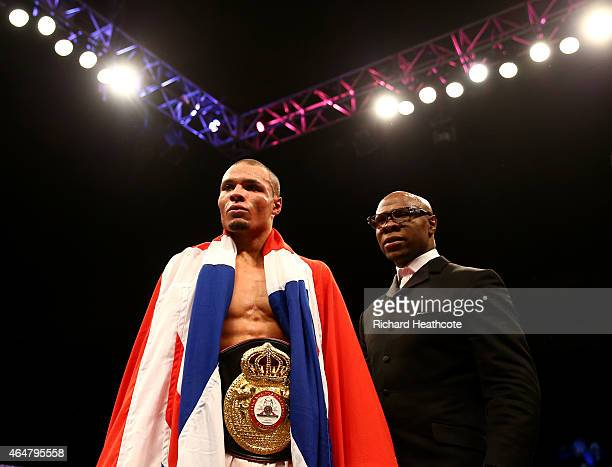 Chris Eubank Jnr is watched by his father Chris Eubank as he celebrates victory over Dmitry Chudinov for the WBA Interim World Middleweight...
