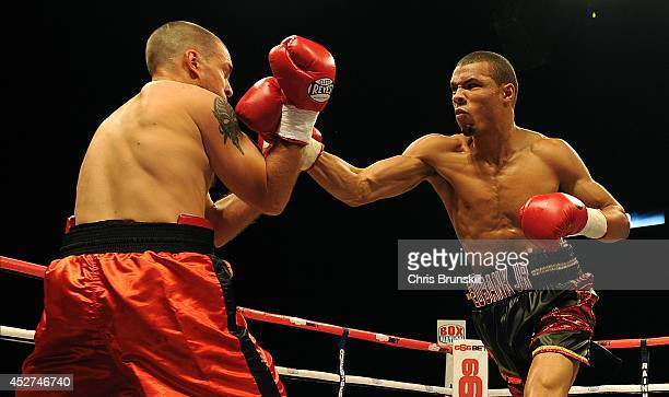 Chris Eubank Jnr of Great Britain exchanges blows with Ivan Jukic of Croatia during their middleweight fight at the Phones 4u Arena on July 26 2014...