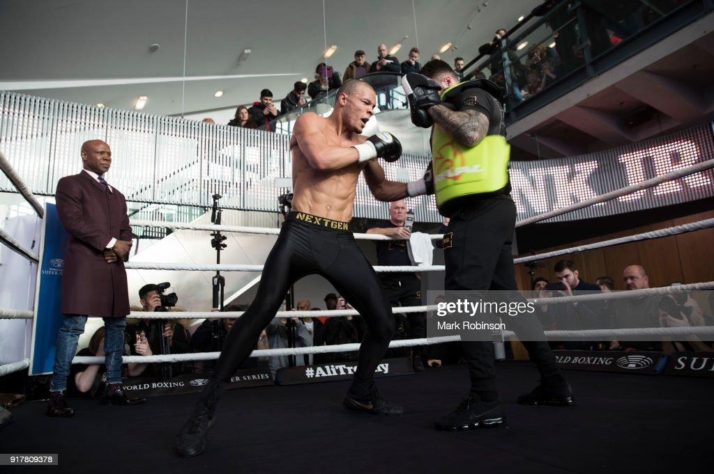 Chris Eubank Jnr takes part in a public work out, watched by his father Chris Eubank (L) at National Football Museum on February 13, 2018 in Manchester, England.