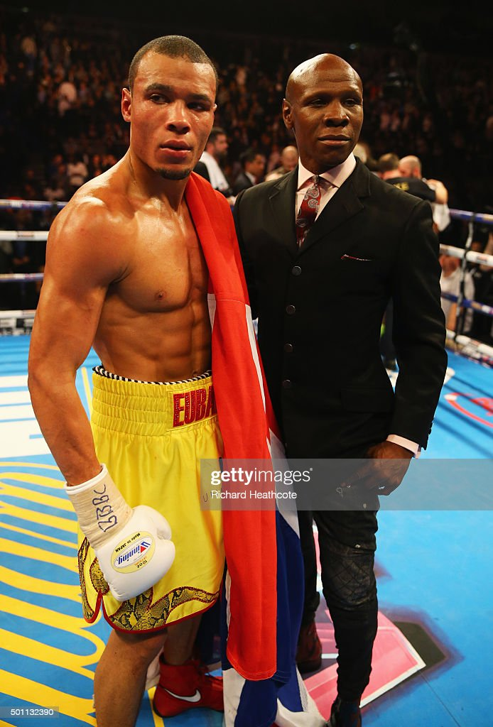 Chris Eubank Jr celebrates victory over Gary O'Sullivan alongside father Chris Eubank after the WBA Middleweight final eliminator contest at The O2 Arena on December 12, 2015 in London, England.
