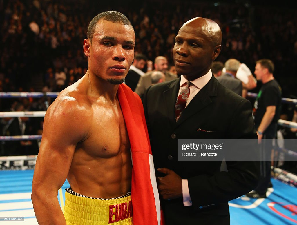 Chris Eubank Jr celebrates victory over Gary O'Sullivan with father Chris Eubank after the WBA Middleweight final eliminator contest at The O2 Arena on December 12, 2015 in London, England.