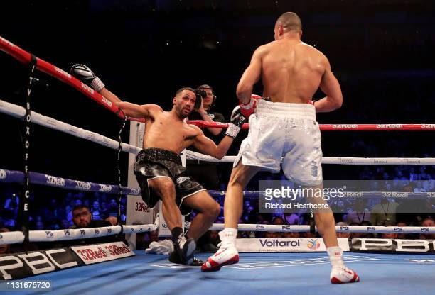 Chris Eubank Jr knocks down James DeGale during the IBO World Super Middleweight Title fight between James DeGale and Chris Eubank Jr at The O2 Arena...