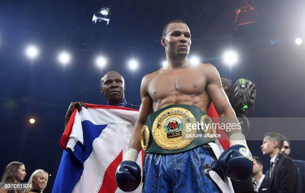 Chris Eubank Jr of Great Britain and his coach and father Chris Eubank stand together after their victory at the super middleweight quarterfinals of...