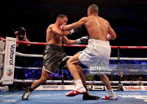Chris Eubank Jr punches James DeGale during the IBO World Super Middleweight Title fight between James DeGale and Chris Eubank Jr at The O2 Arena on...