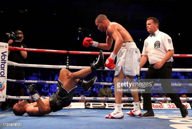 Chris Eubank Jr throws James DeGale to the ground during the IBO World Super Middleweight Title fight between James DeGale and Chris Eubank Jr at The...